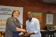 Dean of Research congratulationing Mr Nzimande